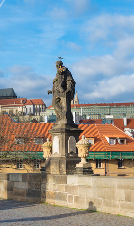 replaced: Religious statue on the famous Charles bridge in Prague. The bridge is decorated by 30 statues and statuaries, most of them baroque-style, originally erected around 1700 but now all replaced by replicas.