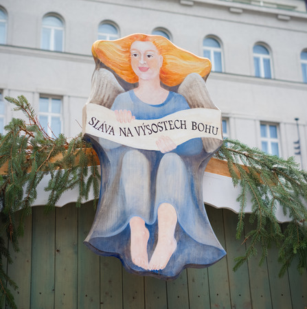 czech women: plate of an christmas angel with a czech saying on it meaning Glory in the highest God