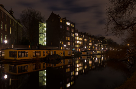 amsterdam canal: houseboat in an amsterdam canal at night Stock Photo