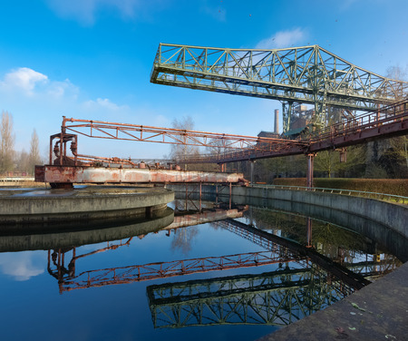 shut down: Old water purification basin at the Landschaftspark Duisburg-Nord, a public park in the German city of Duisburg. The centerpiece of the park is formed by the ruins of a blast furnace complex shut down in 1985. Stock Photo