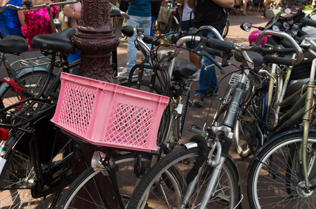 gay pride: pink basket on a bicycle in amsterdam during the 2015 gay pride