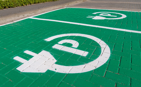 parking place with charging symbol for electric cars Фото со стока