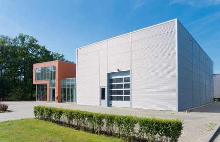 building exterior: exterior of a modern warehouse building with office