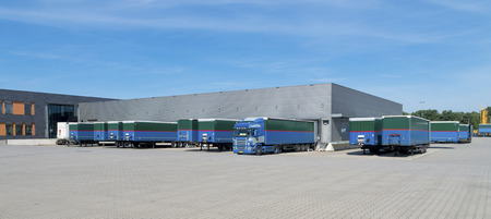 warehouse building: trailers in front of a large warehouse building Stock Photo