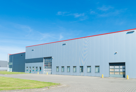 exterior of a large modern warehouse in the netherlands Standard-Bild