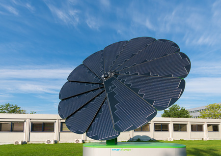 solar collector: GRONINGEN, NETHERLANDS - AUGUST 22, 2015: Smart flower foldable solar collector on the groningen university area. The smart flower provides all the energy for the exterior lighting of the campus sports center
