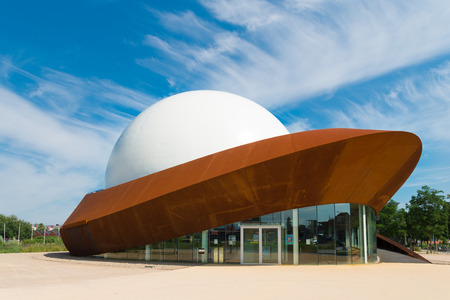 comtemporary: GRONINGEN, NETHERLANDS - AUGUST 22, 2015: Infoversum 3D theatre exterior. It is the only full dome cinema in the netherlands. It consists of a projection dome with a magnitude of 23 meters, surrounded by a construction of Cor-ten steel.