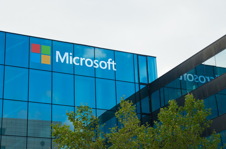 AMSTERDAM - AUGUST 28, 2015:  Microsoft logo on office building at amsterdam schiphol airport Editorial