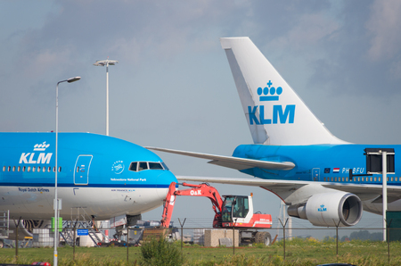 klm: AMSTERDAM - AUGUST 28, 2015: KLM Royal Dutch airlines boeing airplane at schiphol airport. KLM is the national airline company and the third largest employer in the netherlands