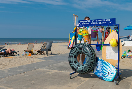 WIJK AAN ZEE, NETHERLANDS - AUGUST 30, 2015: Beach shop with text saying toys and sunburn available inside. The North sea coast measures 353 km in the netherlands