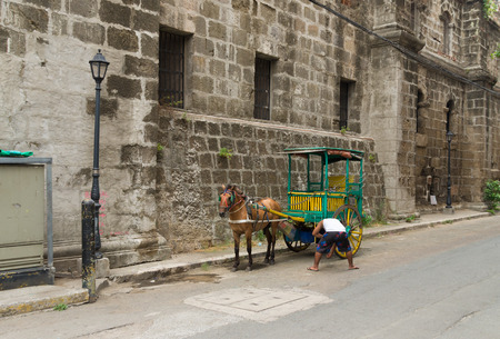 horse drawn carriage: MANILA, PHILIPPINES - JUNE 7, 2015: Horse drawn carriage in Intramuros, the monumental spanish part of Manila