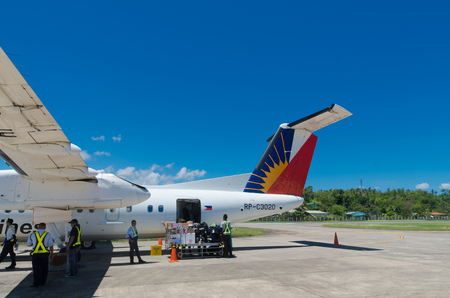 pal: MANILA, PHILIPPINES - MAY 13, 2015: Propeller jet of Philippine Airlines (PAL) being unloaded. Since July 10, 2013 the airline no longer on the blacklist of the European Union Editorial