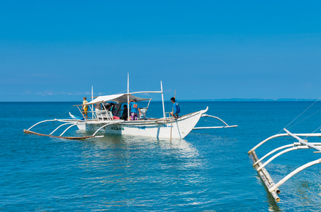 unspoilt: DONSOL, PHILIPPINES - MAY 30, 2015: Traditional philippine bangkas with tourists on their way to see the whale sharks in the surrounding waters
