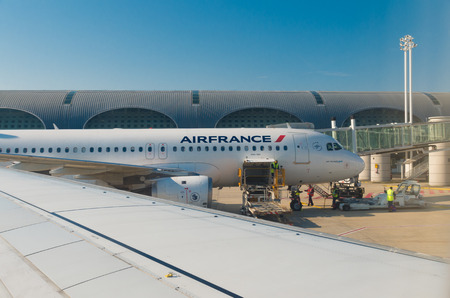handled: PARIS - JUNE 11, 2015: Airfrance plane at the Roissy Charles de Gaulle International Airport (CDG). In 2013, the airport handled 62,052,917 passengers and 497,763 aircraft movements Editorial