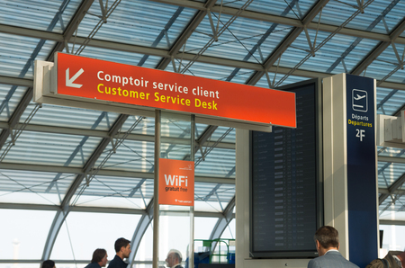charles de gaulle: PARIS - JUNE 11, 2015: Customer service dest at terminal 2F at the Roissy Charles de Gaulle International Airport (CDG). In 2013, the airport handled 62,052,917 passengers and 497,763 aircraft movements