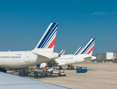 charles de gaulle: PARIS - JUNE 11, 2015: Airfrance plane at the Roissy Charles de Gaulle International Airport (CDG). It is the French flag carrier headquartered in Tremblay-en-France, (north of Paris). Editorial