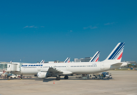 charles de gaulle: PARIS - JUNE 11, 2015: Airfrance plane at the Roissy Charles de Gaulle Airport CDG. It is the French flag carrier Headquartered in Tremblay-en-France, north of Paris.