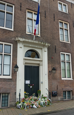 french doors: AMSTERDAM - NOVEMBER 15, 2015: Flowers in front of the French consulate in Amsterdam because of the bloody attacks in Paris