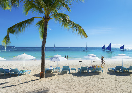 philippines: BORACAY, PHILIPPINES - MAY 5, 2015: Tourists on tropical beach. Boracay is one of the main tourist attractions in the philippines because of its white beaches