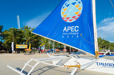 promotes: BORACAY, PHILIPPINES - MAY 20, 2015: Sailing boat with APEC sail. Asia-Pacific Economic Cooperation (APEC) is a forum for 21 Pacific Rim member economies that promotes free trade throughout the Asia-Pacific region. Editorial