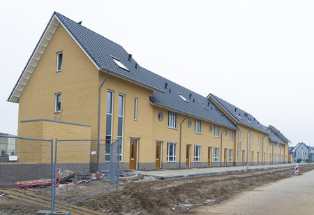 typically dutch: row of newly build terraced houses in the netherlands