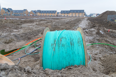 fiberoptic: UTRECHT, NETHERLANDS - FEBRUARY 7, 2015: Drum with blue fiber optic cable on it, owned by Ziggo, the largest cable television operator in the Netherlands