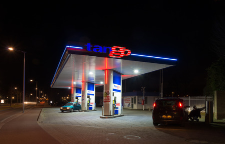 unleaded: OLDENZAAL, NETHERLANDS - FEBRUARY 28, 2015: Tango gas station at night. Tango CV, a dutch company, introduced and operates unmanned gasoline stations. In 2013 they owned 150 stations.