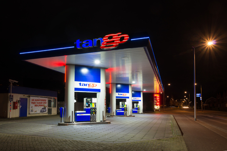 opec: OLDENZAAL, NETHERLANDS - FEBRUARY 28, 2015: Tango gas station at night. Tango CV, a dutch company, introduced and operates unmanned gasoline stations. In 2013 they owned 150 stations.
