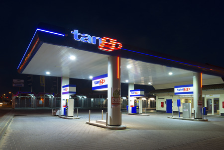 unleaded: ENSCHEDE, NETHERLANDS - FEBRUARY 28, 2015: Tango gas station at night. Tango CV, a dutch company, introduced and operates unmanned gasoline stations. In 2013 they owned 150 stations.