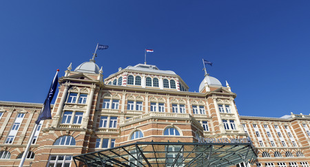 scheveningen: SCHEVENINGEN, NETHERLANDS - MARCH 8, 2015: Landside exterior of the Grand Hotel Amrath Kurhaus hotel located in front of Scheveningens beach. The hotel has over 250 rooms Editorial