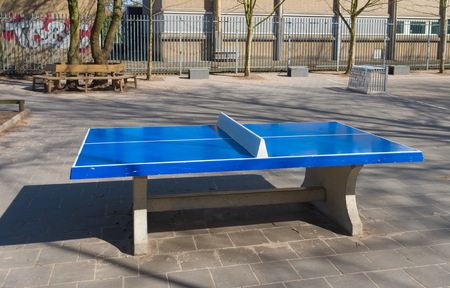 schoolyard: blue outdoor table tennis table on a schoolyard