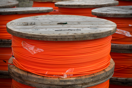 fiberoptic: cable drums with orange fiber cable on a construction site