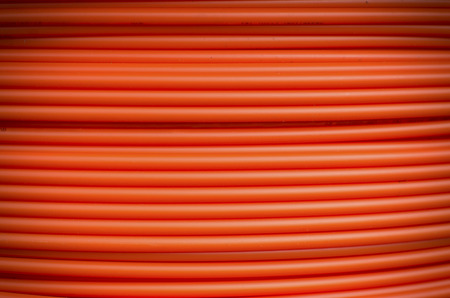 fiberoptic: closeup of orange fiber cable on a construction site