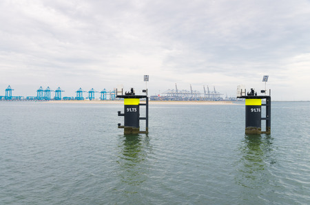 meant: two mooring posts in the rotterdam harbor, meant for flexible, efficient and risk-free ship to ship transfer Stock Photo
