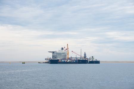 multipurpose: biggest crane vessel in the rotterdam harbor Stock Photo