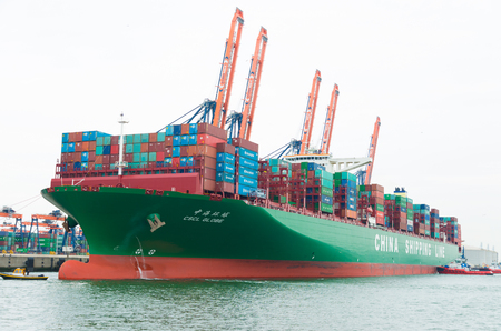 ROTTERDAM, NETHERLANDS - JUNE 28, 2015: CSCL Globe container ship mooring in the Rotterdam harbor. The CSCL Globe measures 400 meters in length, 58.6 meters in width and 30.5 meters in depth.