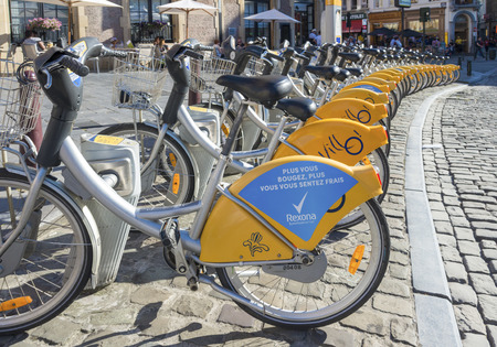 velo: BRUSSELS, BELGIUM - JULY 10, 2015: Yellow bikes of Villo!, an automated service that rents bicycles throughout Brussels. Editorial