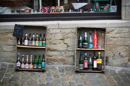 brasserie: BRUSSELS, BELGIUM - JULY 12, 2015: Various Belgian beers in front of a touristic beer shop. In Belgium there are about 130 breweries in the country, which produce about 1000 different beers.