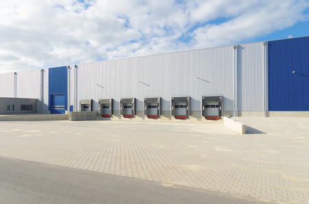 exterior of a newly build warehouse with loading docks Stock Photo
