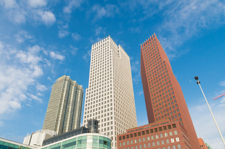 royal family: THE HAGUE, NETHERLANDS - OCTOBER 3, 2015: Modern skyscrapers in the city center of The Hague. The Dutch government and parliament are located in the city, and it is the residence of the royal family