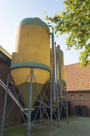two silos for animal food storage