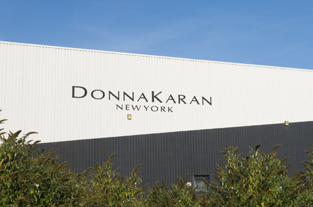 donna: OLDENZAAL, NETHERLANDS - OCTOBER 31, 2015: Exterior of a Donna Karan warehouse. She is one of the most influential fashion designers in American fashion Editorial