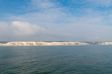 dover: The famous Dover chalk cliffs seen from a ferry boat Stock Photo