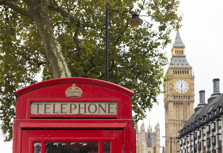 typically english: typically english red phone booth in london with the Big Ben in the background Editorial