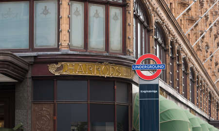 knightsbridge: LONDON, ENGLAND - OCTOBER 19, 2015: London underground sign at the famous Harrods store in the Knightsbridge district