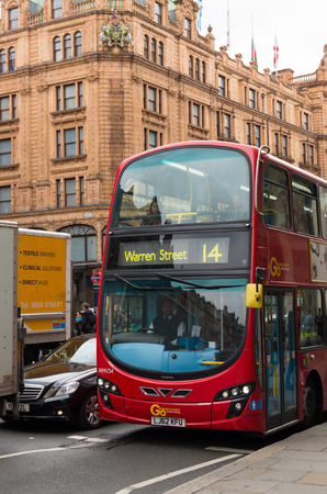 harrods: LONDON - OCTOBER 19, 2015: Famous red double decker bus in front of the harrods store in the knightbridge district Editorial