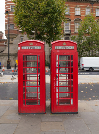 typically english: Two typically english red phone booths in London Stock Photo