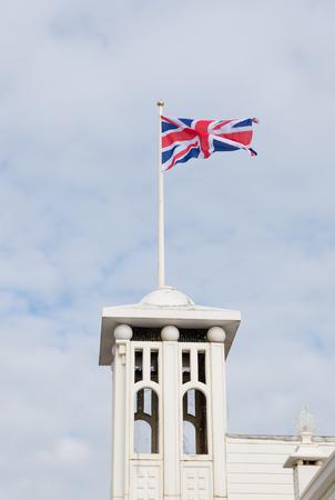 london to brighton: british flag waving on top of the brighton pier Stock Photo