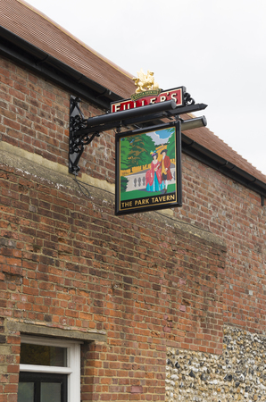 traditionally: CHICHESTER, ENGLAND - OCTOBER 22, 2015: Traditionally english tabern sign in the old city of Chichester