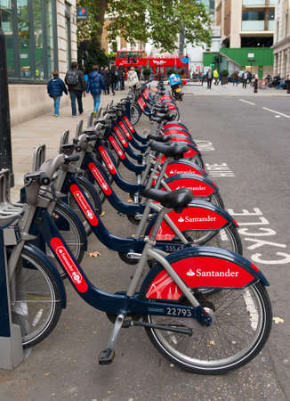 rented: LONDON, ENGLAND - OCTOBER 23: Santander rental bikes for hire in London. These cycles can be rented at a series of locations around the city and are ofter call Boris bikes after the Mayor of London.